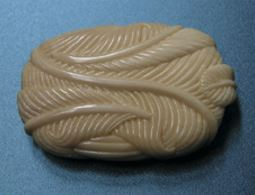 A feather bundle by Owen Mapp carved from mammoth ivory