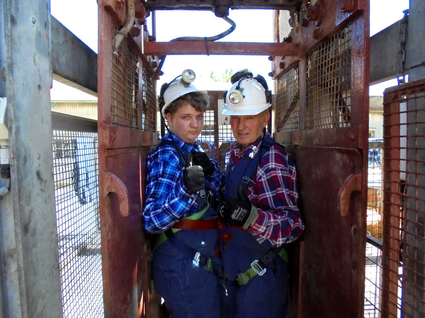 Me (on the right) with a fellow miner in the original lift.