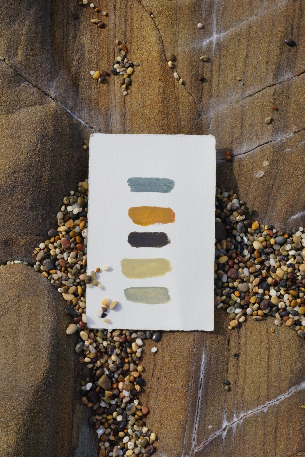 Color palette that matches the pebbles found in the landscape it is based from.