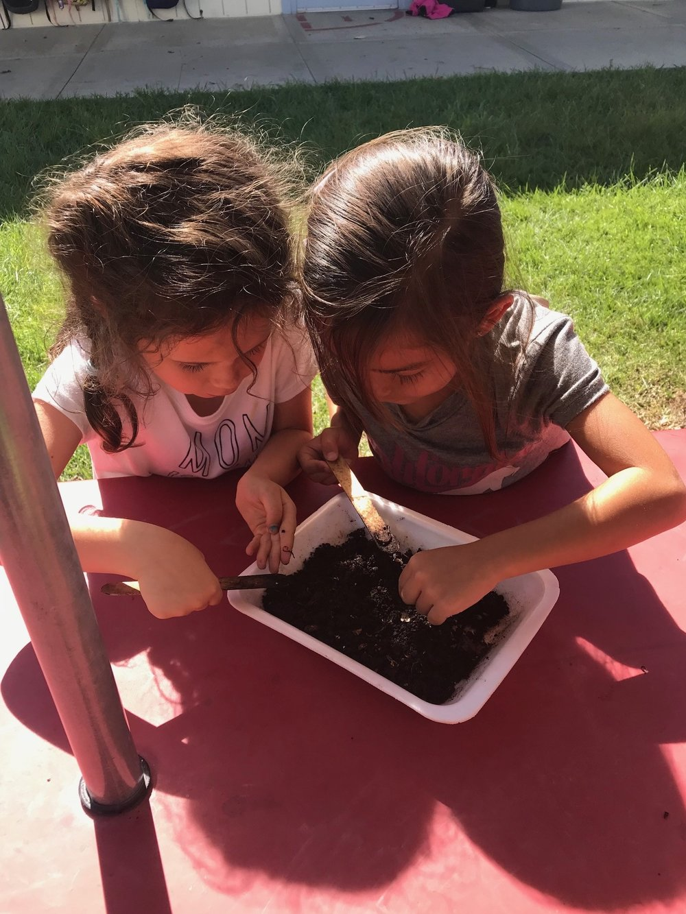 As a teacher, what brings Estefani great joy is finding ways to make learning fun and interactive for her students. Here are two of her kindergarten students getting their hands dirty during a lesson.
