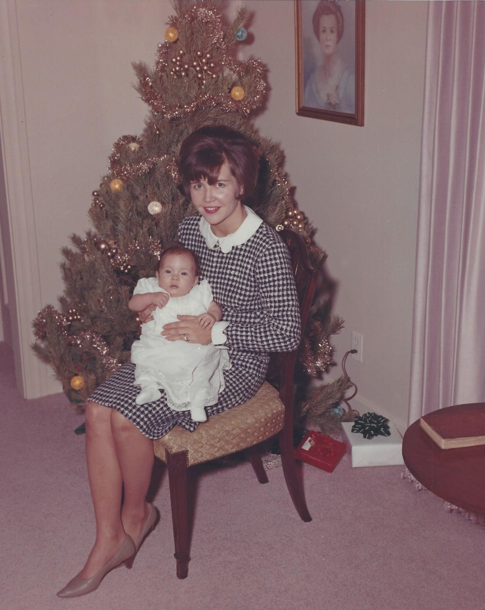Page with her mom on the day of her baptism (1966).
