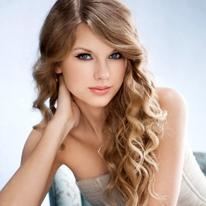 1235529-taylor-swift-woman-of-the-year-617-409.jpg