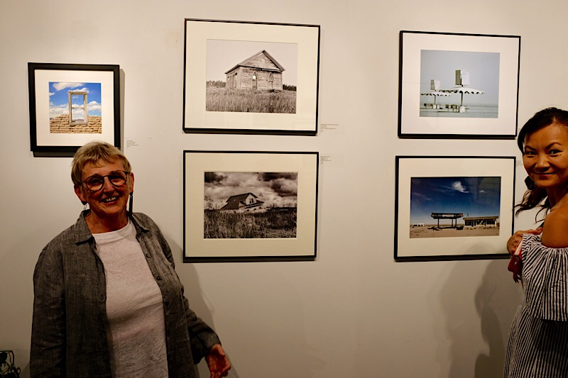Nancy Albert, happy in front of her photograph,  Abandoned Church, Nova Scotia . You can check out more of Nancy's work  here .