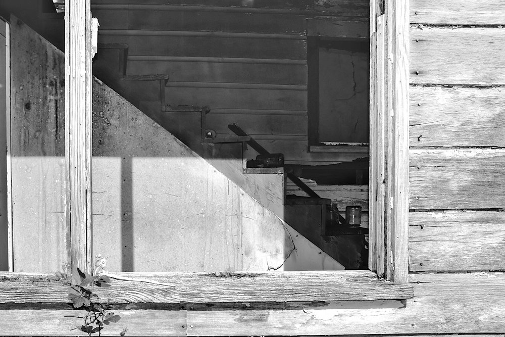 The Backstairs , in black and white, with more emphasis on the texture in the wood.