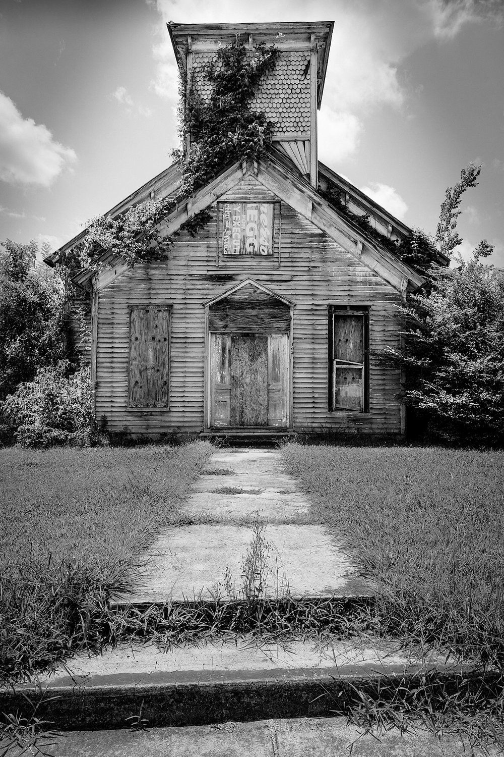 In God We Trust , an abandoned church included in the book, and a very popular print.