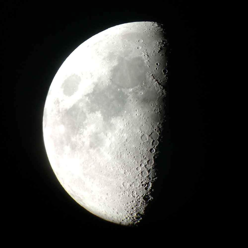 This photo was taken by aiming a smartphone camera lens through eyepiece of a telescope at Star*Quest Observatory.