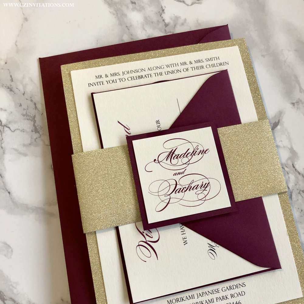 burgundy and gold wedding invitation with glitter belly band cz