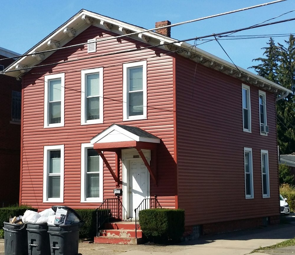 The Red House - 306 West 8th St. Erie, PA 16502This 4 bedroom home is located in the Presta District with a quick walk to Gannon Campus. Laundry, off street parking and two full bathrooms make this house extremely desirable.