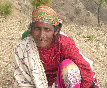Woman on mountain path, Nepal