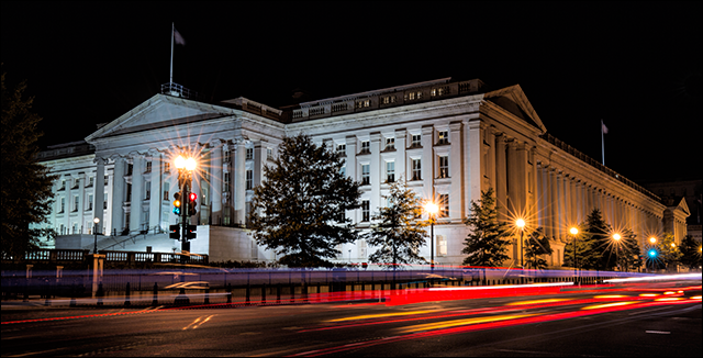 U.S. Treasury Building at night.
