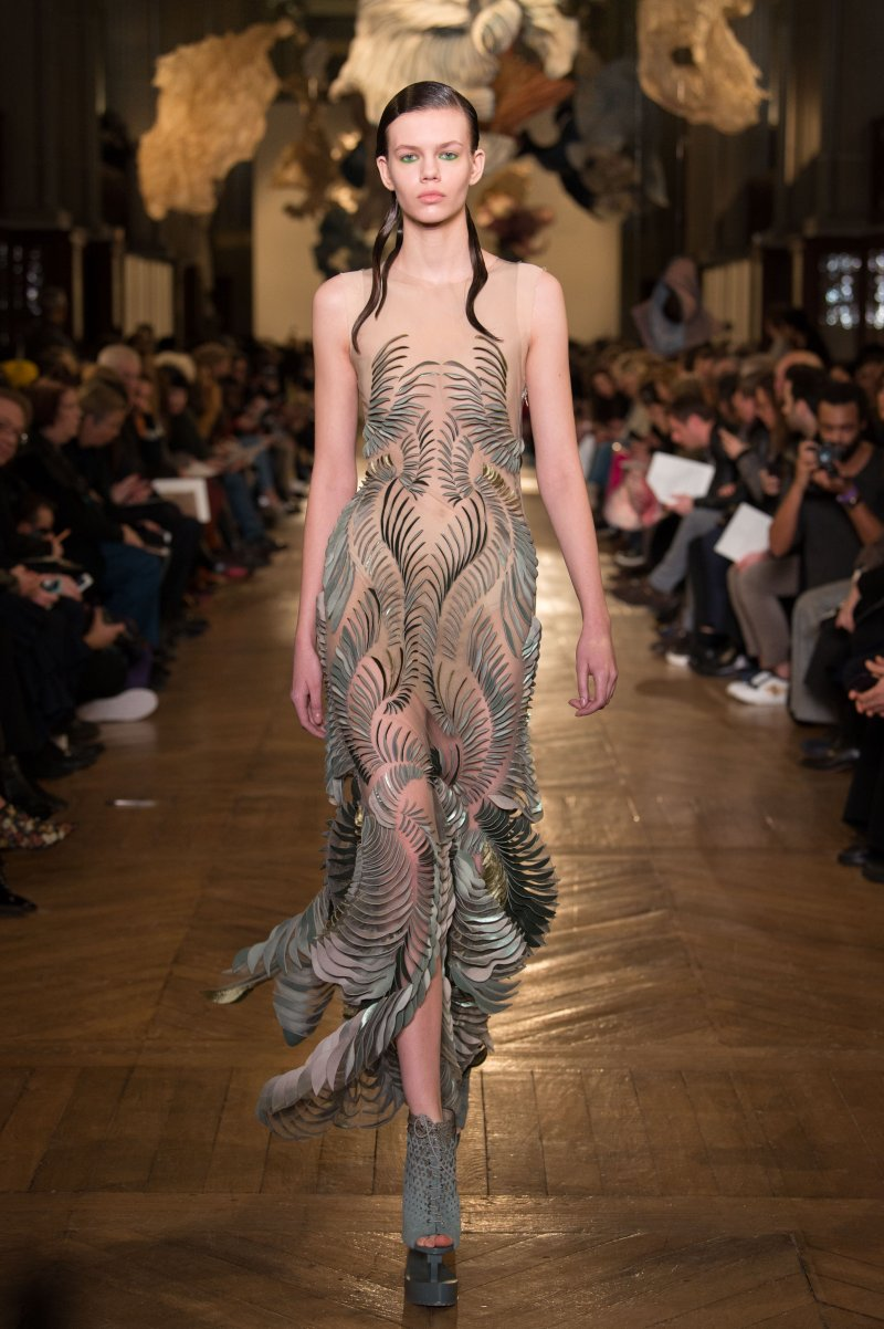 Foliage Dress - Skills used:- Organising digital files to be laser cut (Adobe Illustrator)- Measuring each piece to make sure the dress was    symmetrical, and files were properly laser cut- Bonding silk and velvet together - Placing foliage pieces on tulle- Draping of the dress