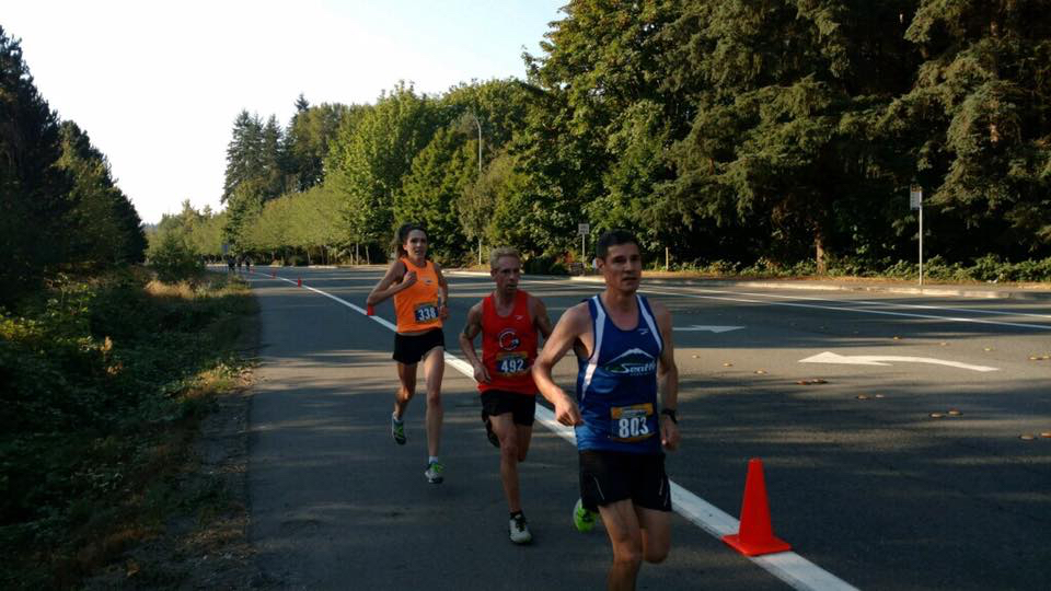 Megan Heuer and Todd Maruca working together at the Labor Day Half