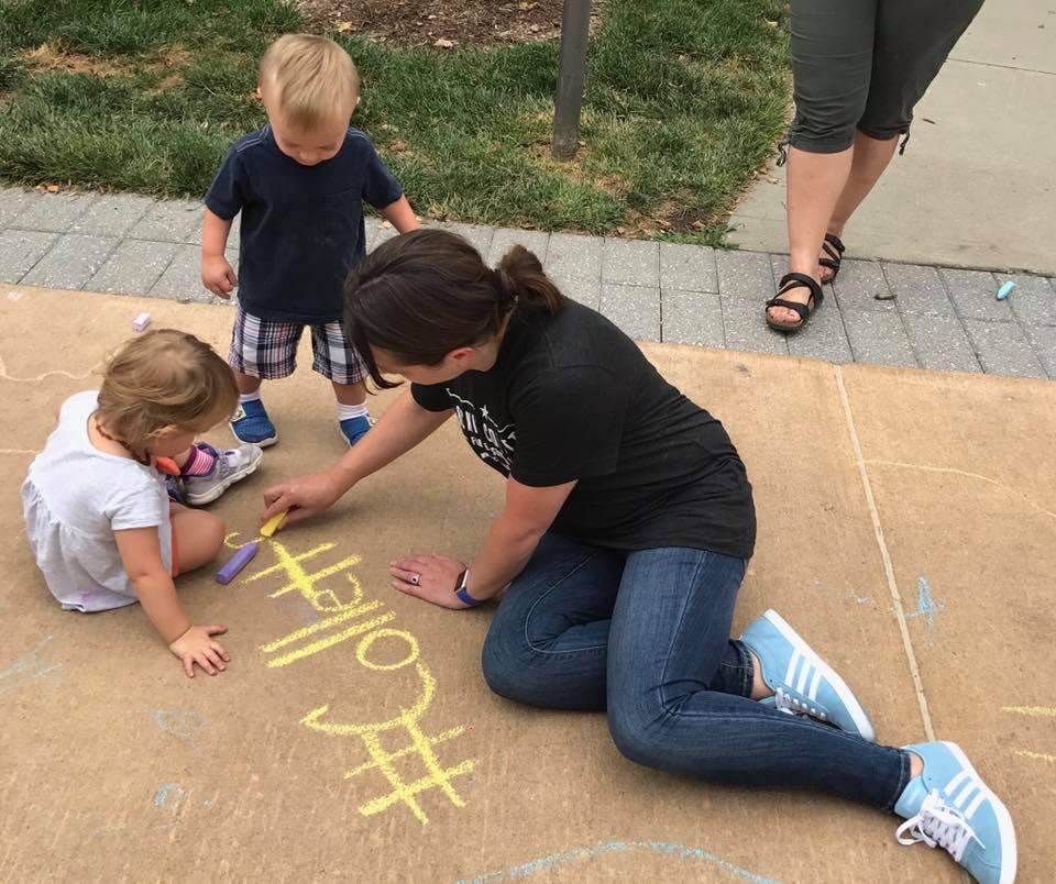Sidewalk chalk and talk.