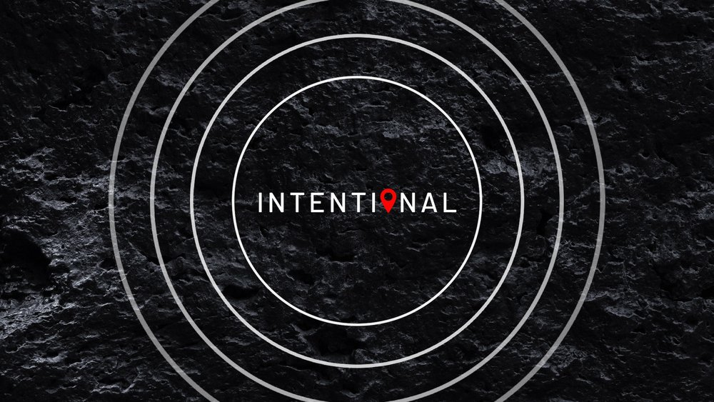 "Four white circles with ""Intentional"" in the middle on a black background"