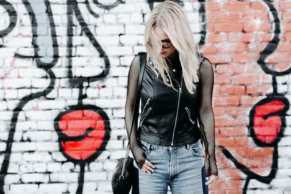 leather vest with fish nets