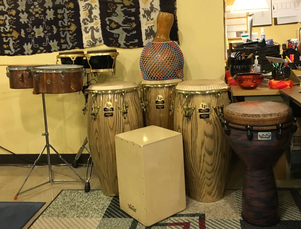 Latin Percussion (L to R): WFL vintage copper timbales, Toca Bongos, LP Giovanni Hidalgo Signature Series Congas, Remo Peruvian Cahon, hand-made shekere, Remo Djembe