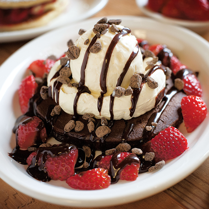 A chocolate pancake with cream, vanilla or chocolate ice-cream, Belgian chocolate chips and our house-made hot chocolate fudge served with fresh strawberries.