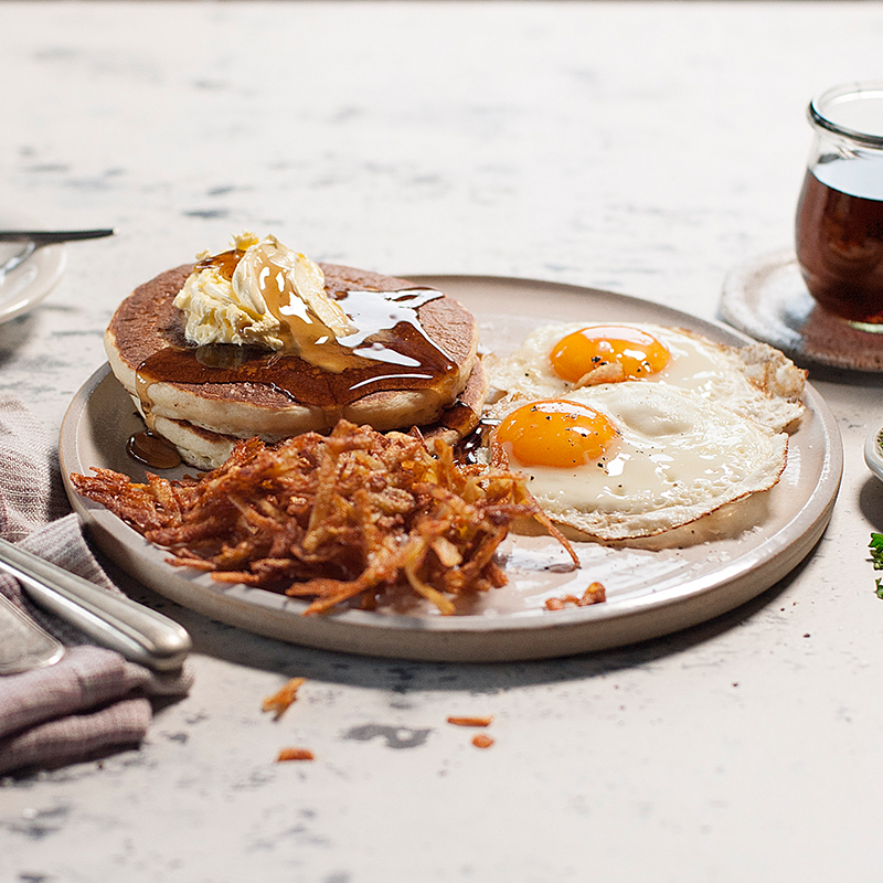Two buttermilk pancakes, house-made hash browns and two free-range eggs served any style with whipped butter and maple-flavoured syrup.