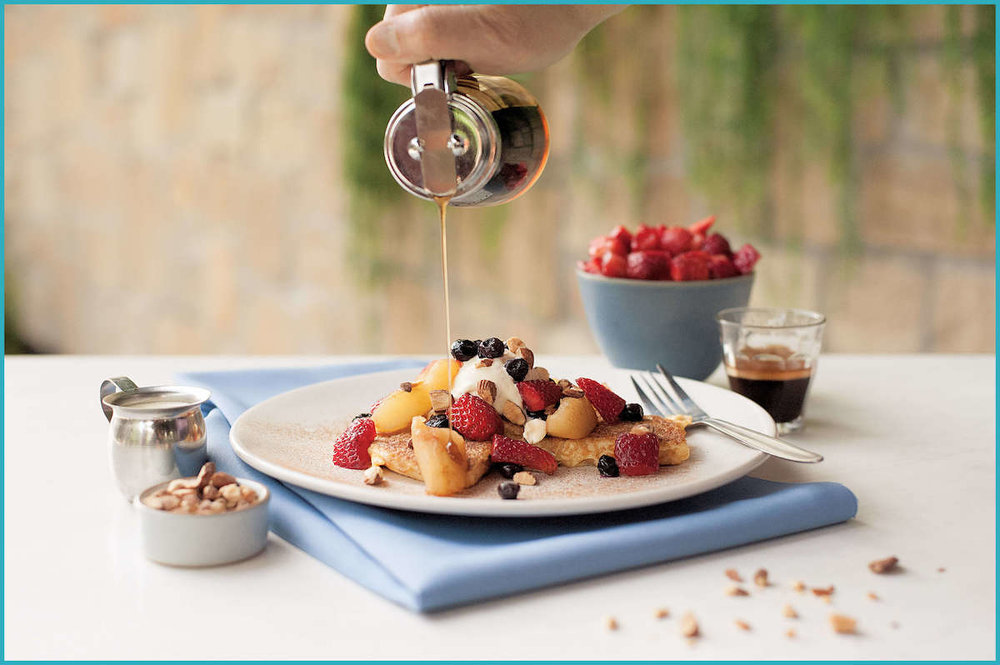 A French toast-style pancake topped with Greek yoghurt, berries, spiced apple and crushed almonds.