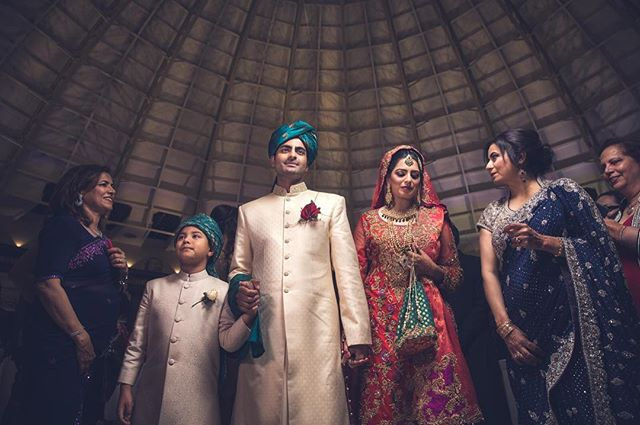 That #moment when your #walking back down the #aisle  #asianwedding #opusultanphotography #osp #bridal #bridalinspiration #groom #groomsinspiration #offcameraflash #emotions #love #memories #red #gold #orange #blue #green #picoftheday #lovemyjob