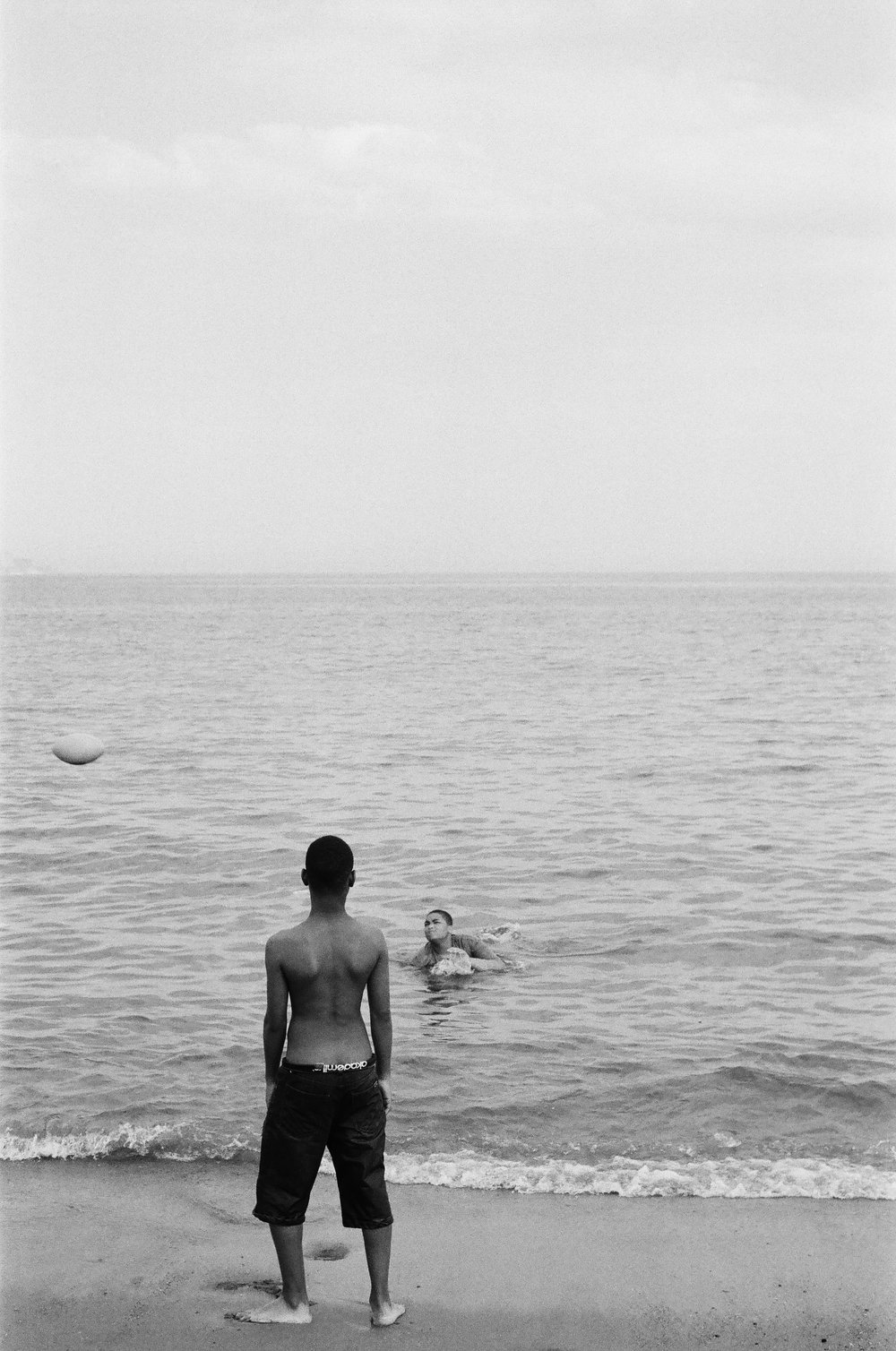 Boys at the beach.   Untitled.