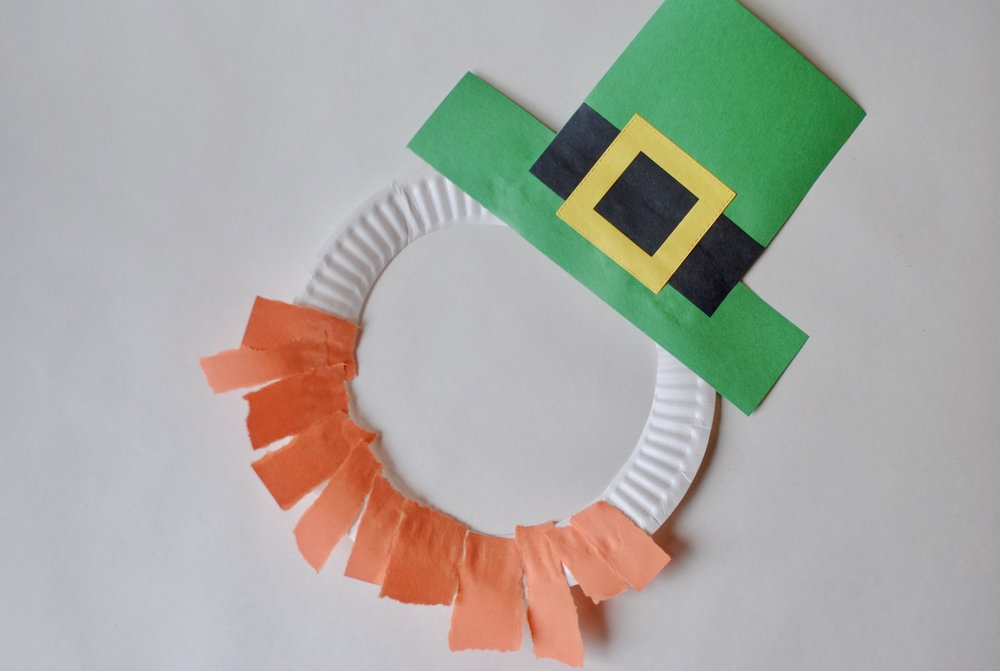 Leprechaun mask - The only tricky part is figuring out how to put the hat together. Arrange the green, black, and yellow paper shapes to look like this.