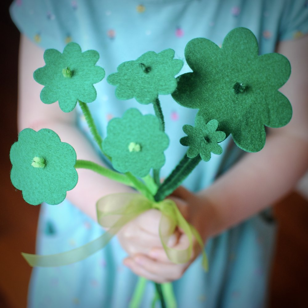 Shamrock bouquet - This craft is easy, as long as you make the holes in the flowers the right size. Don't use anything too big, such as scissors, or the flowers might not stay on the pipe cleaners. A toothpick or skewer will work best.