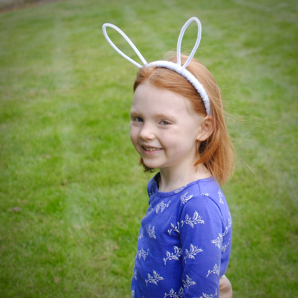 Bunny ears - Wrap the pipe cleaners around the headband so the color doesn't show. Position the ears however you want. Decide whether they should be close together, far apart, or flopped over. Then put them on and hop around like a bunny!