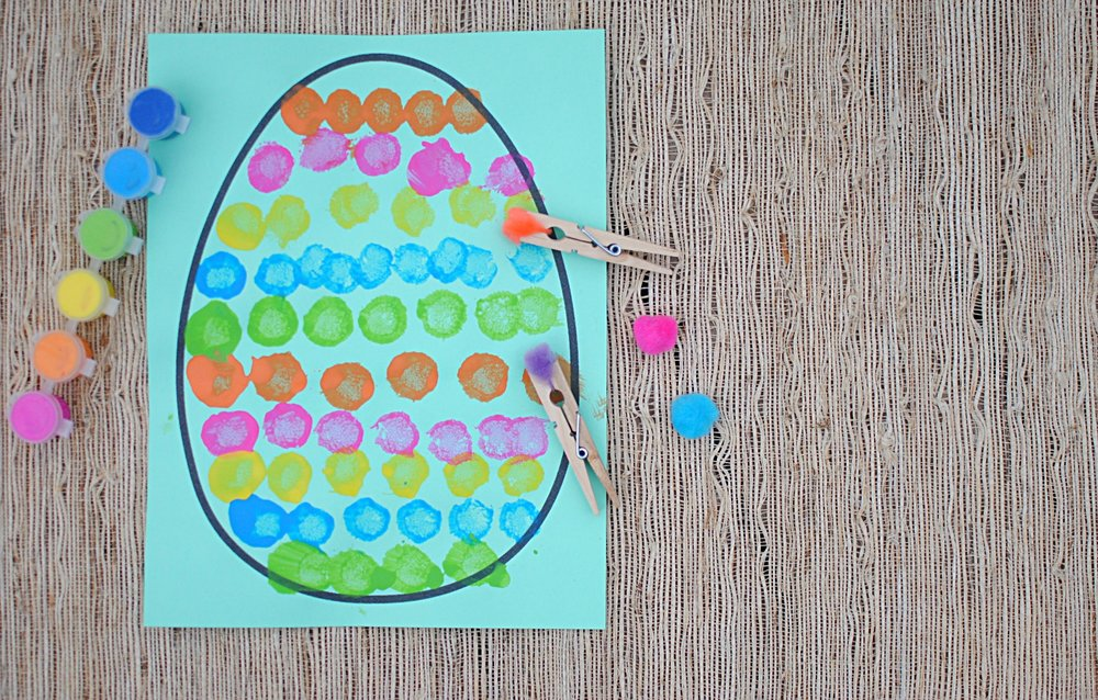Easter egg painting - This is open-ended art, so paint your egg however you'd like! Use the pom-poms and clothes pins as paint brushes and get creative.