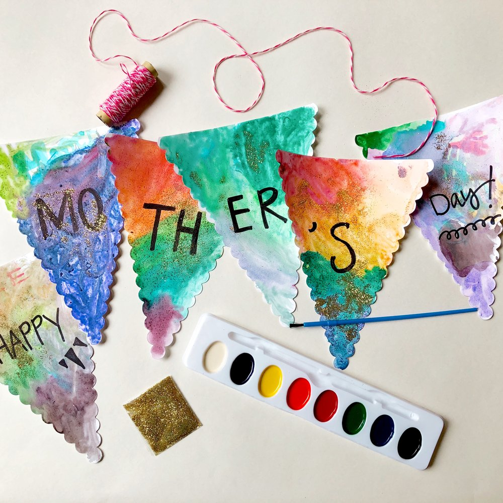 Watercolor Banner - This is open-ended art. Use your watercolors and glitter however you like. Then thread and hang on Mother's Day!