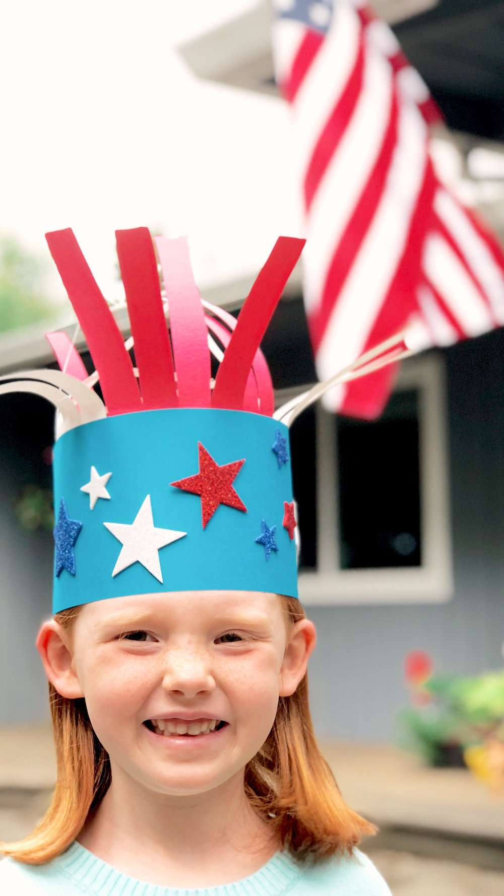 Patriotic Parade Hat - Use two tape dots on each end of the blue paper to form the base of your hat. After you add the foam stars, glue on some of the star confetti pieces to make your hat even more festive!