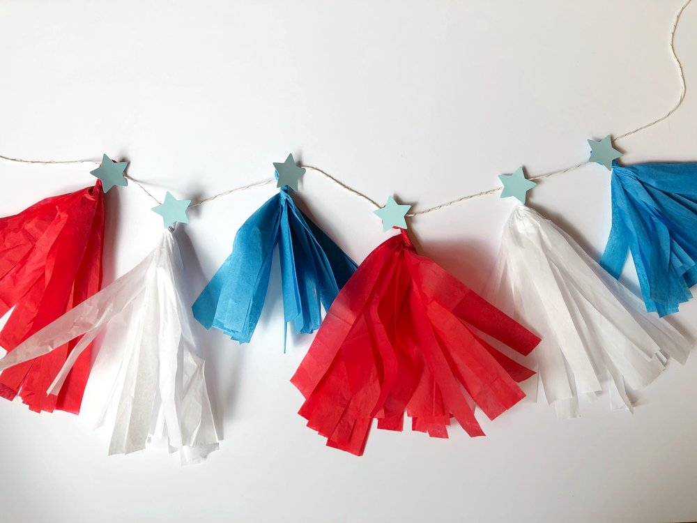 Red, White & Glue Garland - Some crafts are just easier to show than tell. Watch the video below to see us in action! And don't be afraid to email us with any questions.This activity is too tricky for younger kids to do alone.They'll love helping you cut the strips, thread the tissue poms, glue on the stars, and choose a place to hang the finished banner. This is #togetherart at its finest.