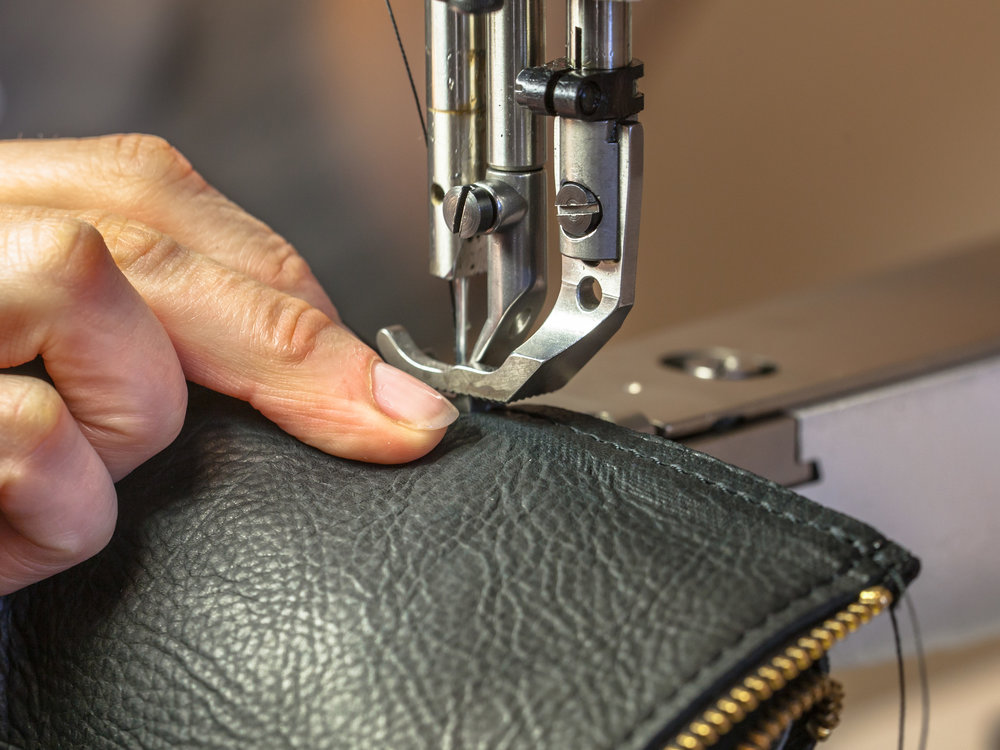 HAND CRAFTED - CHRISTOPHER HANLON® ARTISANS ARE TRAINED EXPERTS PRODUCING SIGNATURE LEATHER GOODS