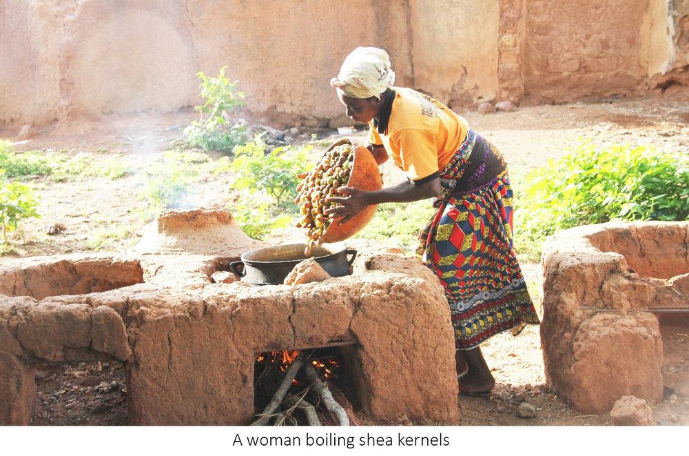 a woman boiling kernels.jpg