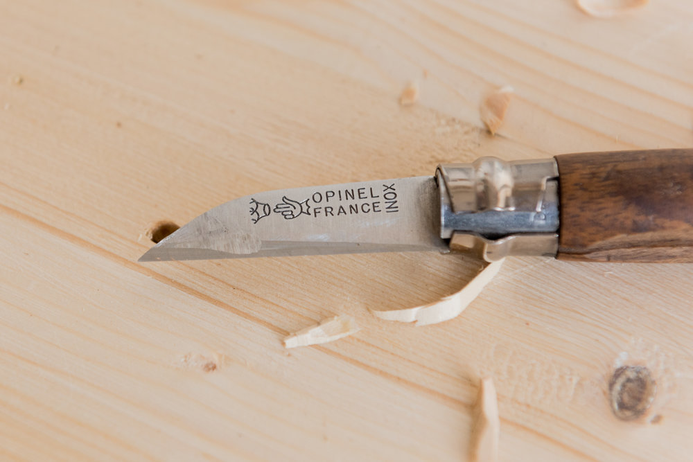 i modified a standard Opinel knife to make it more practical for my needs.