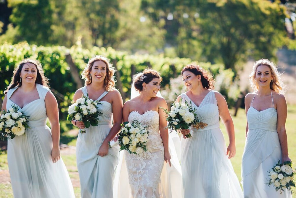 The bridesmaids are wearing Amsale gowns in the colour Ice