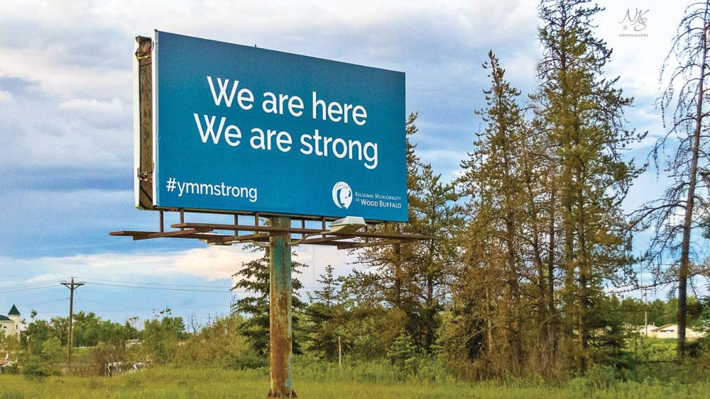 Fort McMurray billboard, months after the wildfires, as evacuated people start to return to the community