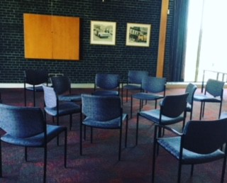 A circle of chairs waiting for the conversation to begin.