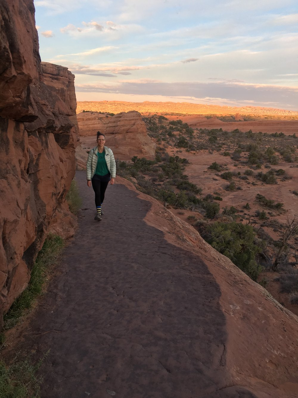 Zoe in Moab, UT. Sunrise hike to Delicate Arch