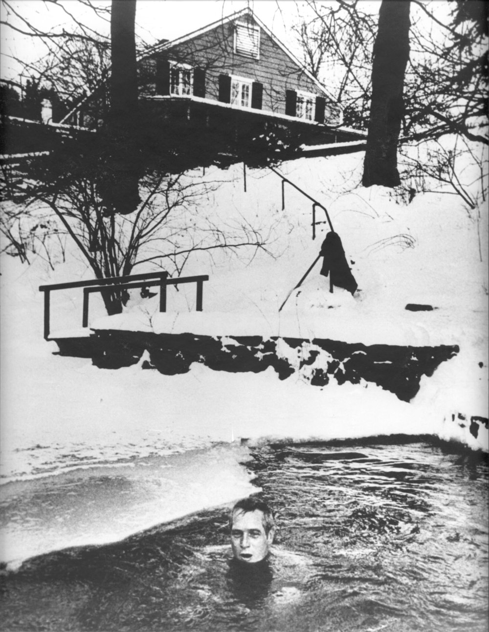 Paul Newman enjoying a winter swim in the Aspetuck river which runs through the preserve.