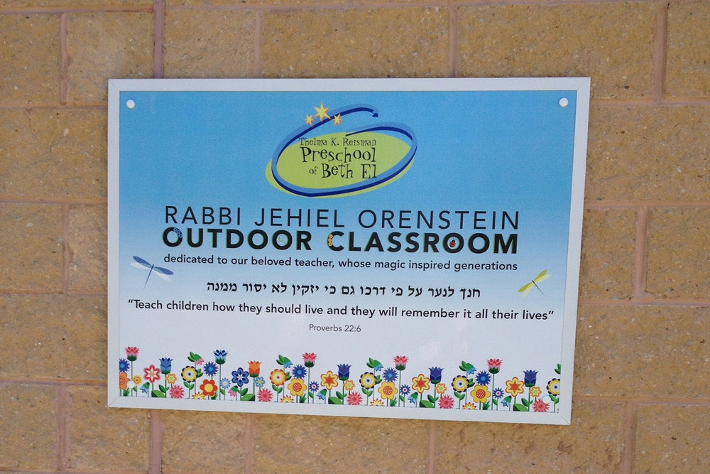 Sign created for the preschool's outdoor classroom, dedicated in memory of the late Rabbi Jehiel Orenstein. (Photo by Joy Markel)