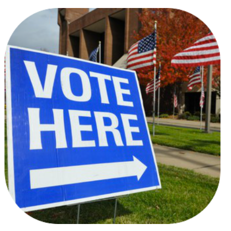 Image of a sign saying Vote Here with an arrow pointing to the polling location