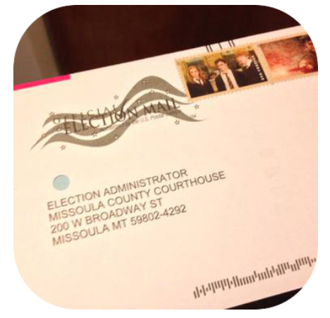 Image of an absentee ballot with two stamps on it