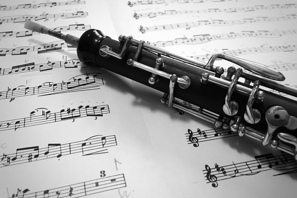 black and white oboe on sheet music