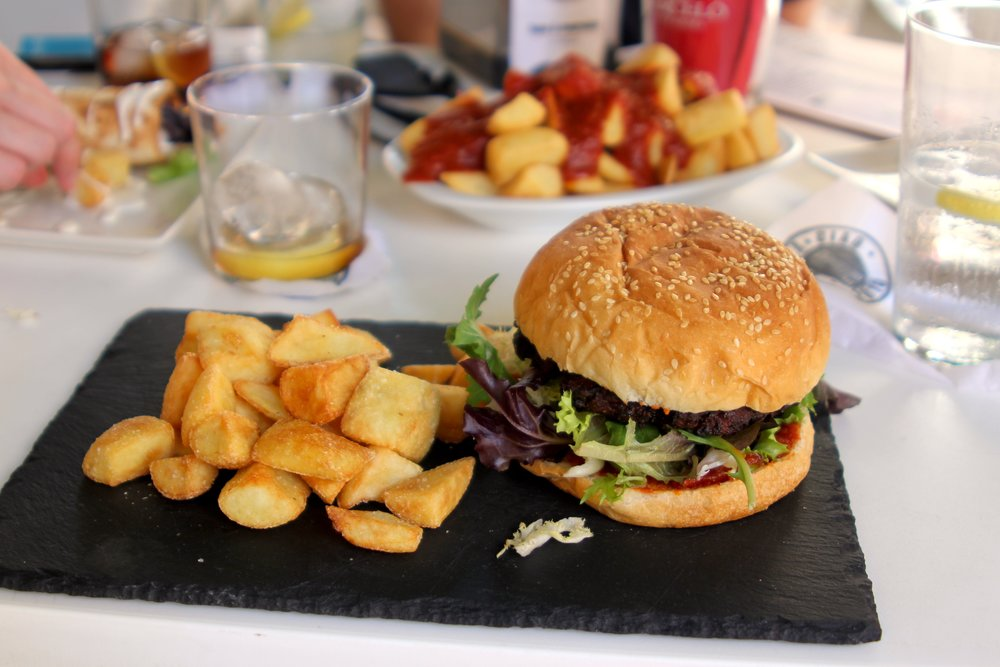 the best soya burger ever (with patatas bravas in the background)