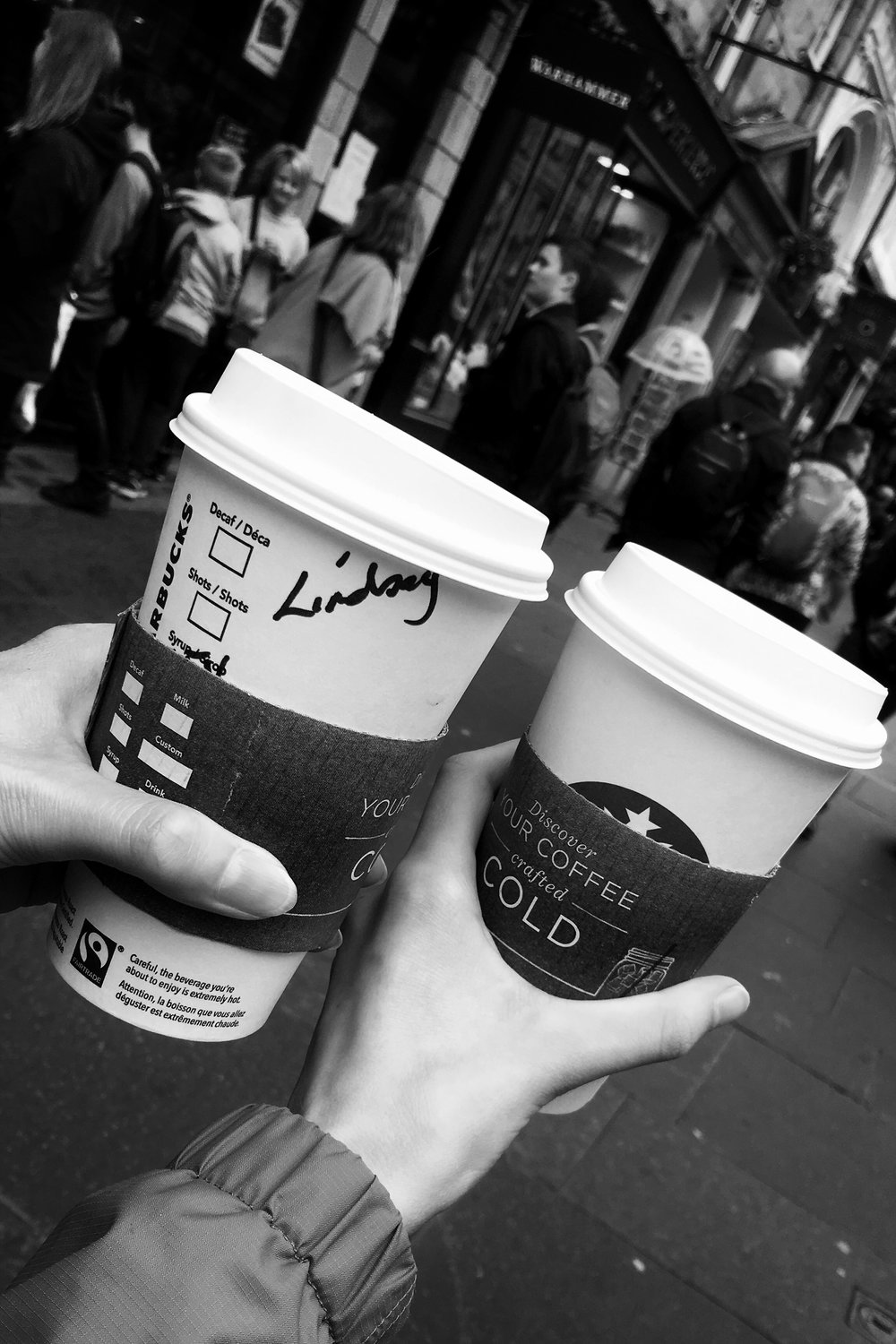 Starbucks takeaway coffee on the Royal Mile in Edinburgh