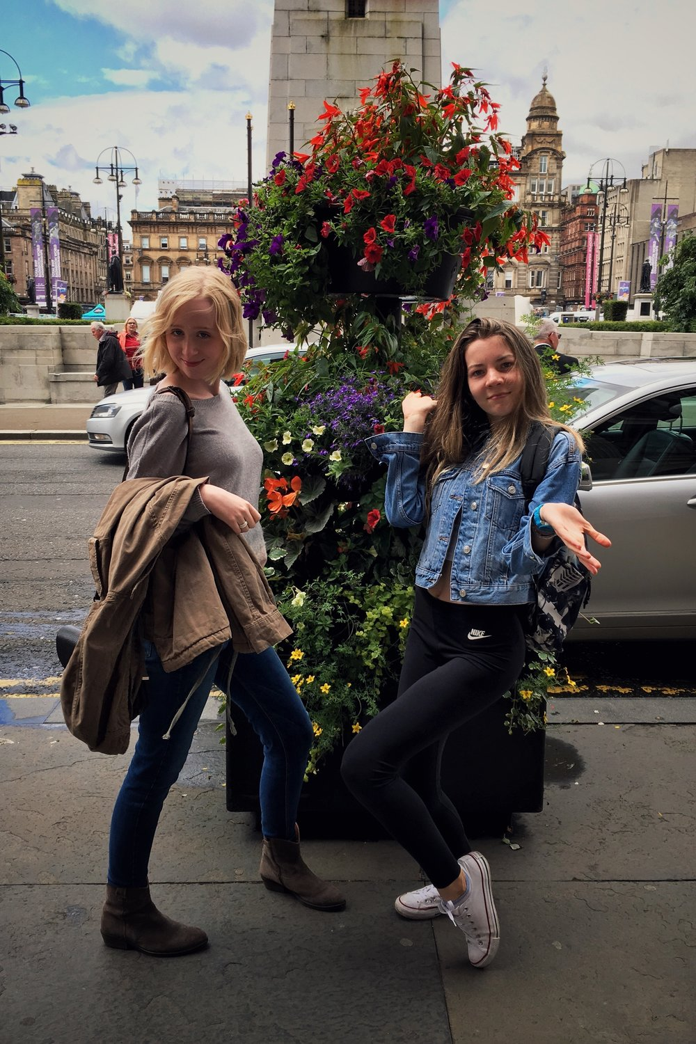 me and Freja posing next to some pretty flowers with George Square in the background