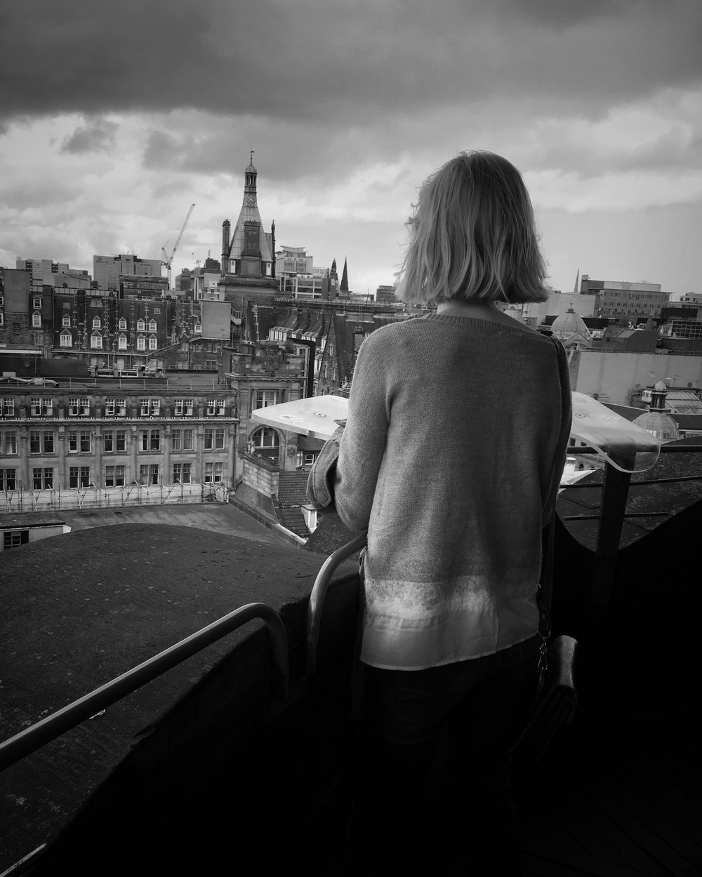 Freja looking out into the distance at all of the buildings
