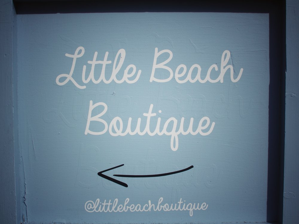sign for Little Beach Boutique