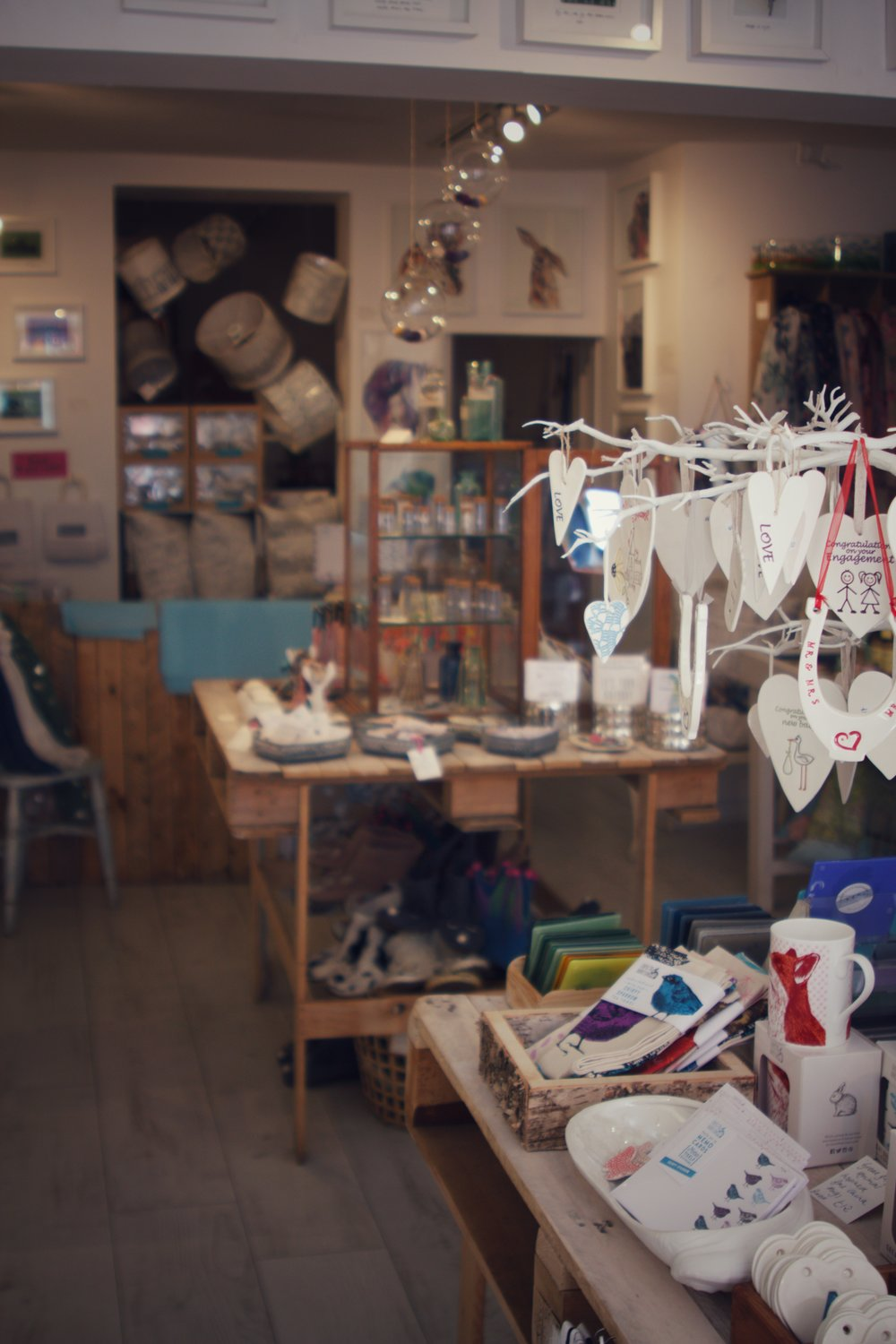 hanging hearts and other gifts inside Little Beach Boutique